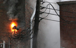DesotoFire2: A small fire burns on wires on the back of the Desoto Theatre on Tuesday. (Ryan Smith, RN-T.com)